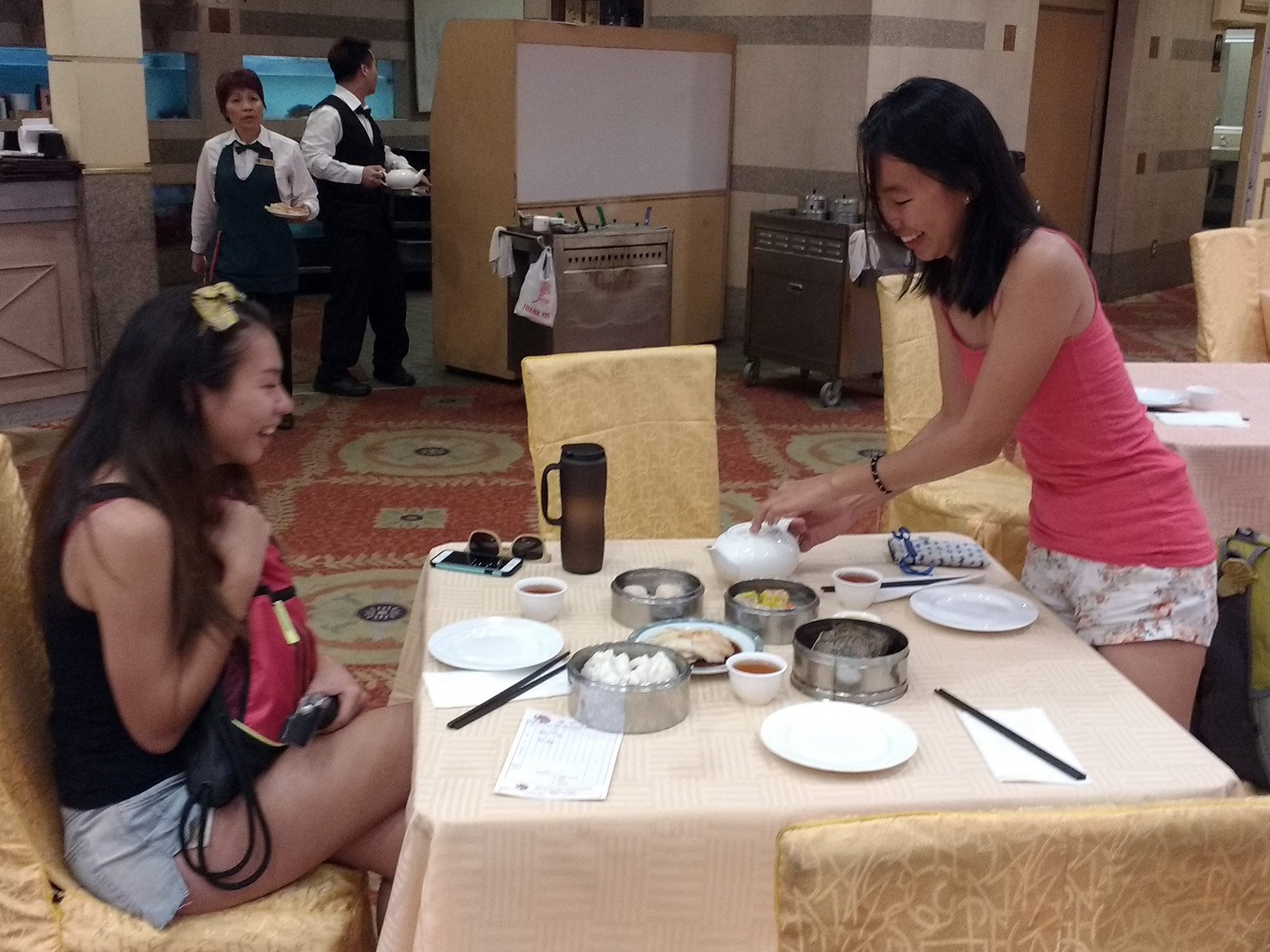 Yen Li pours tea for Maggie at 888 Seafood, a dim sum restaurant