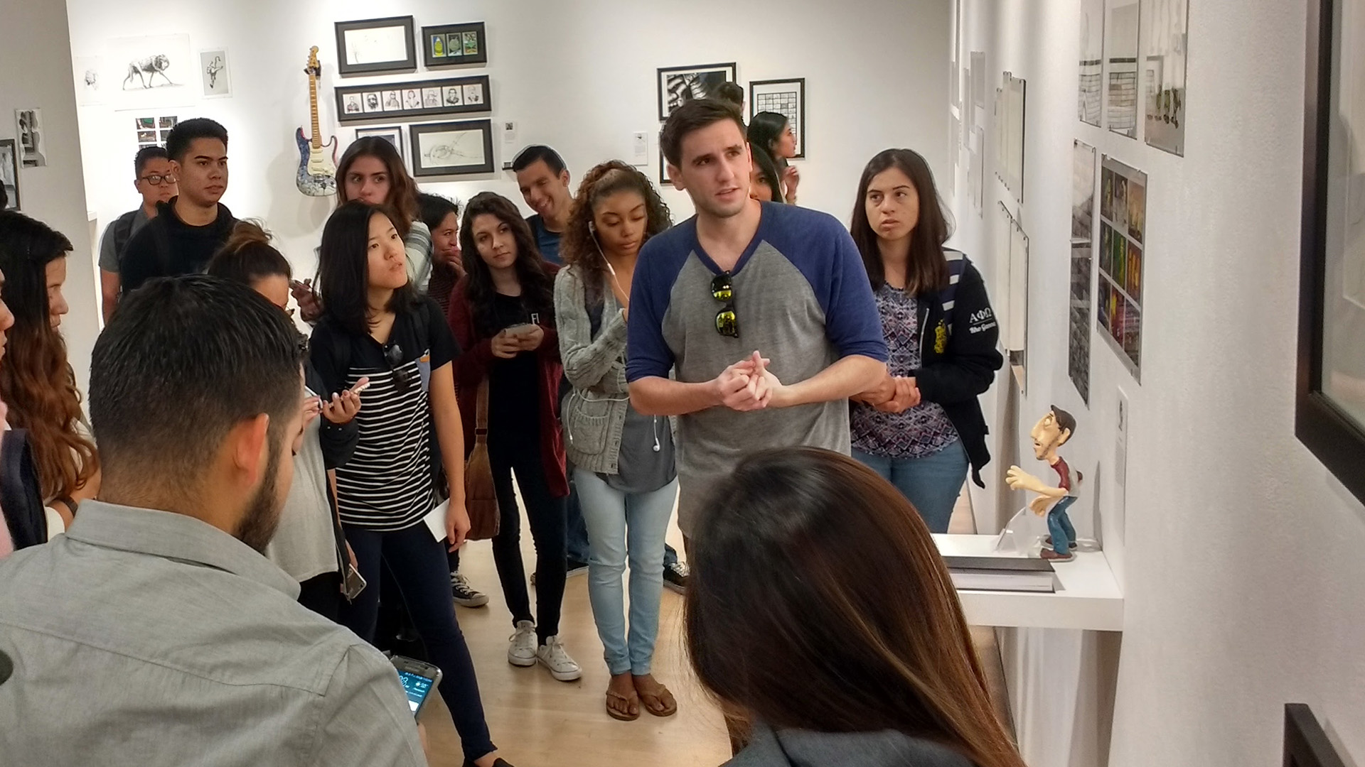 Tyler Turett discussing his BFA Thesis Exhibition with my students