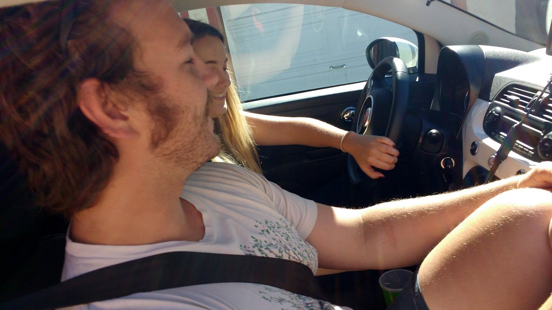 interior shot of 2 people in a Fiat 500