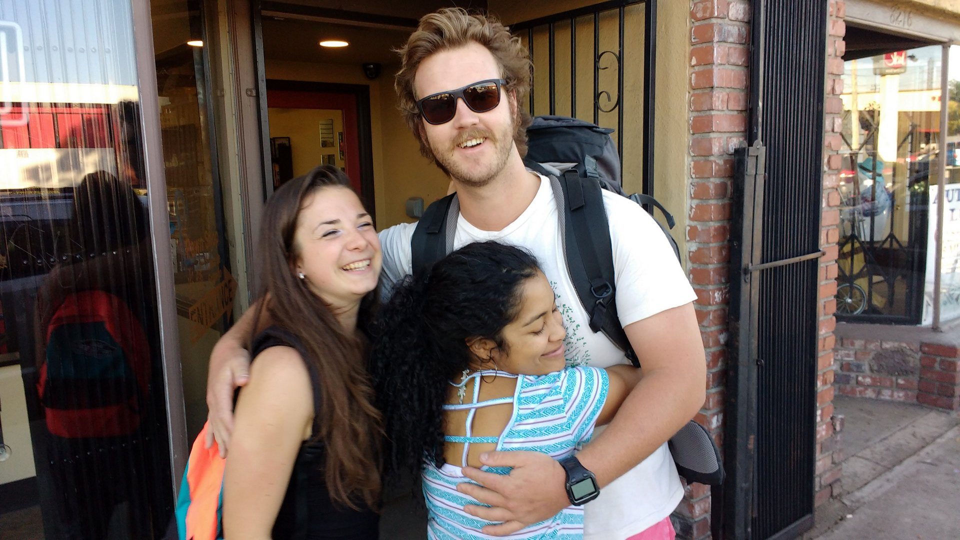Tete, Lucas & Eleo hugging outside the Pawn Shop