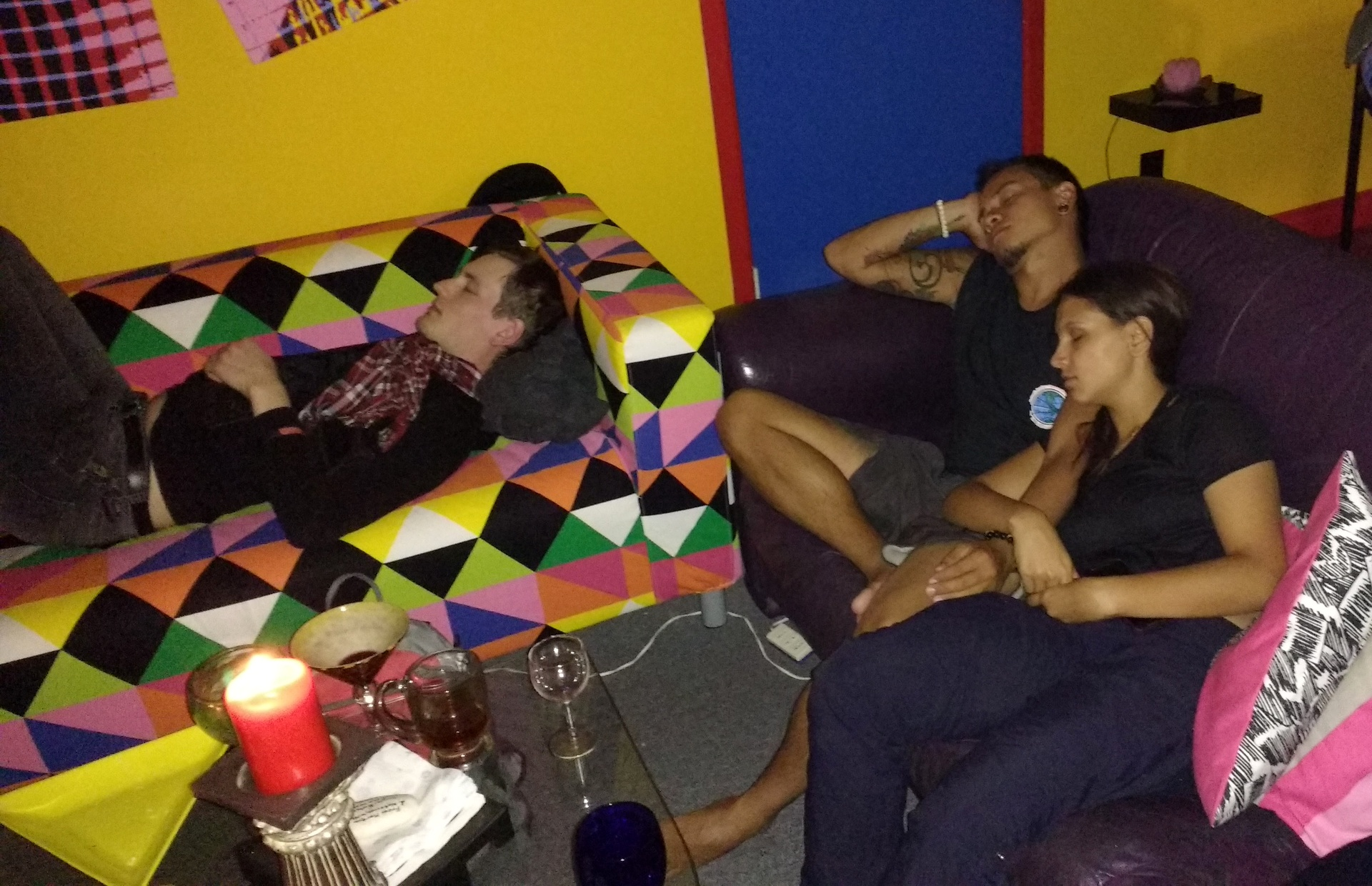 3 people asleep on couches