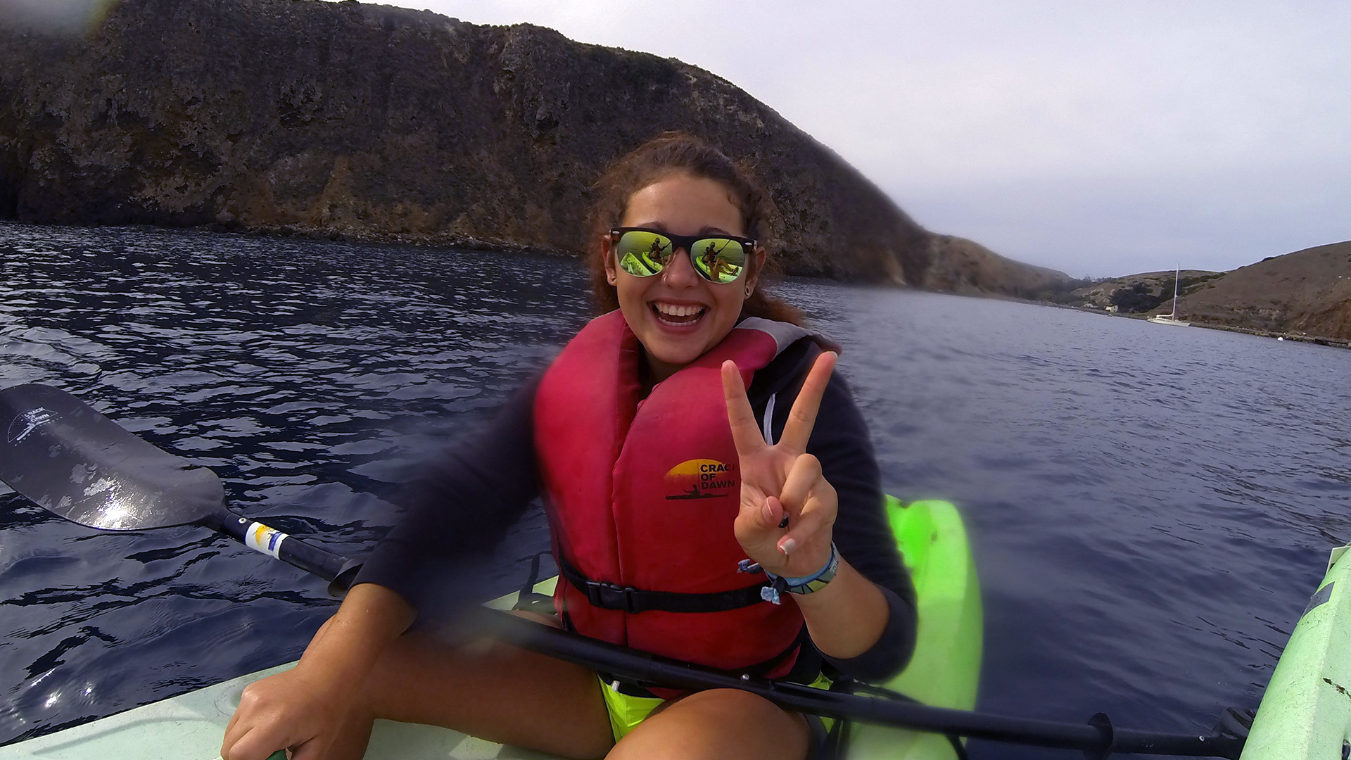 Zeinab Greif with a big smile as she paddles a kayak