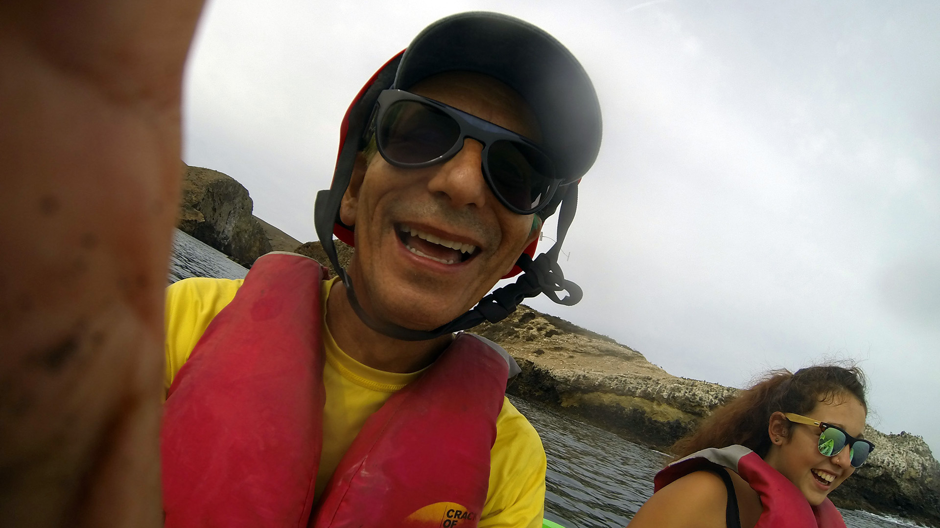 Glenn and Zeinab paddling kayaks and smiling