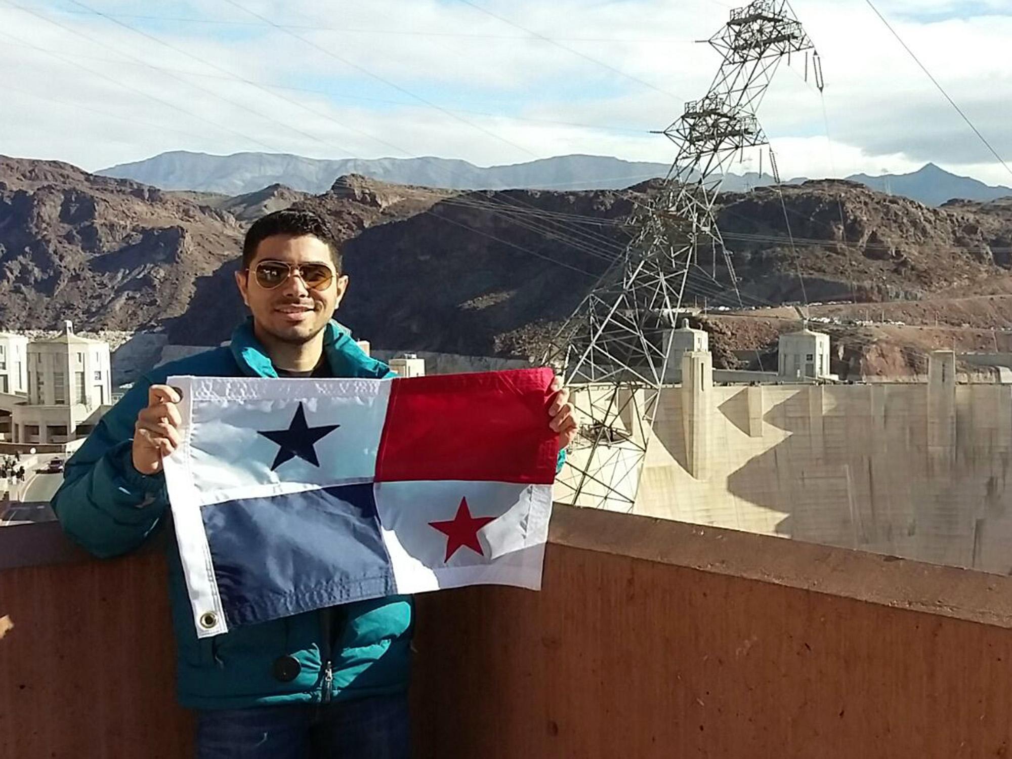 Davis Ureña standing in front of Hoover Dam