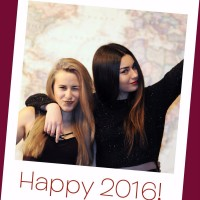 "a ""polaroid"" photo of Maya and Mia with ""Happy 2016"" written on the white border"