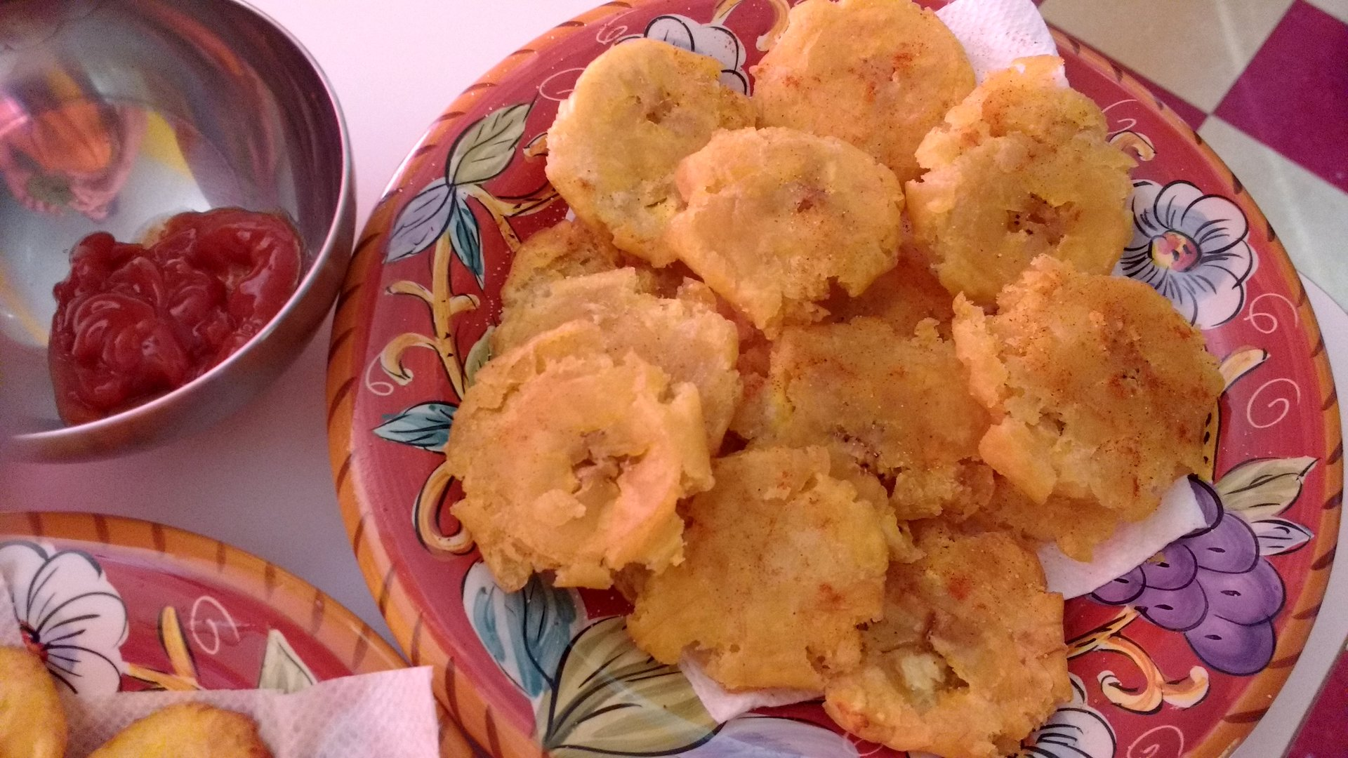 A plate filled with Patacones (unripe, fried plantains)