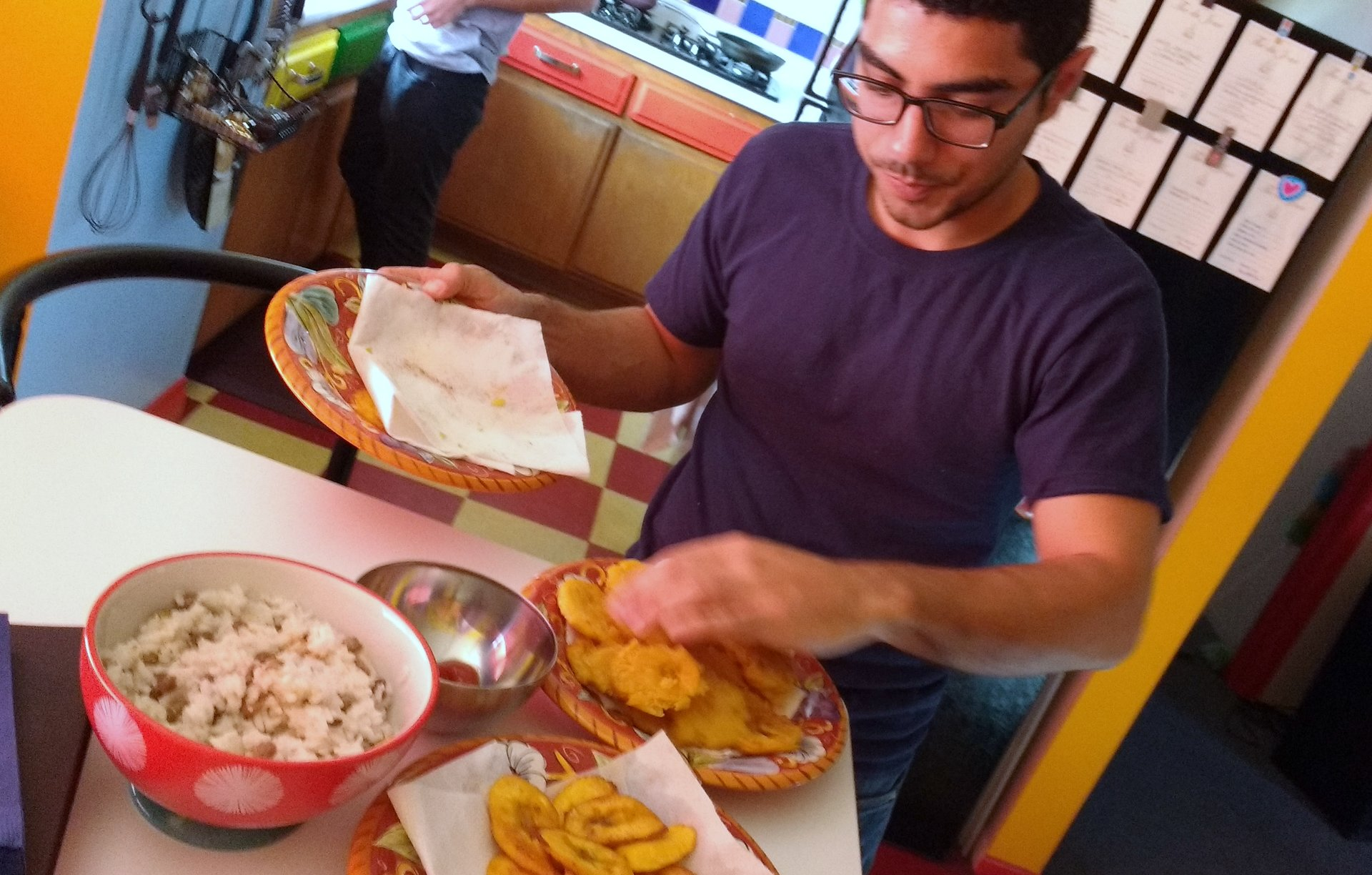 Davis putting patacones on a plate