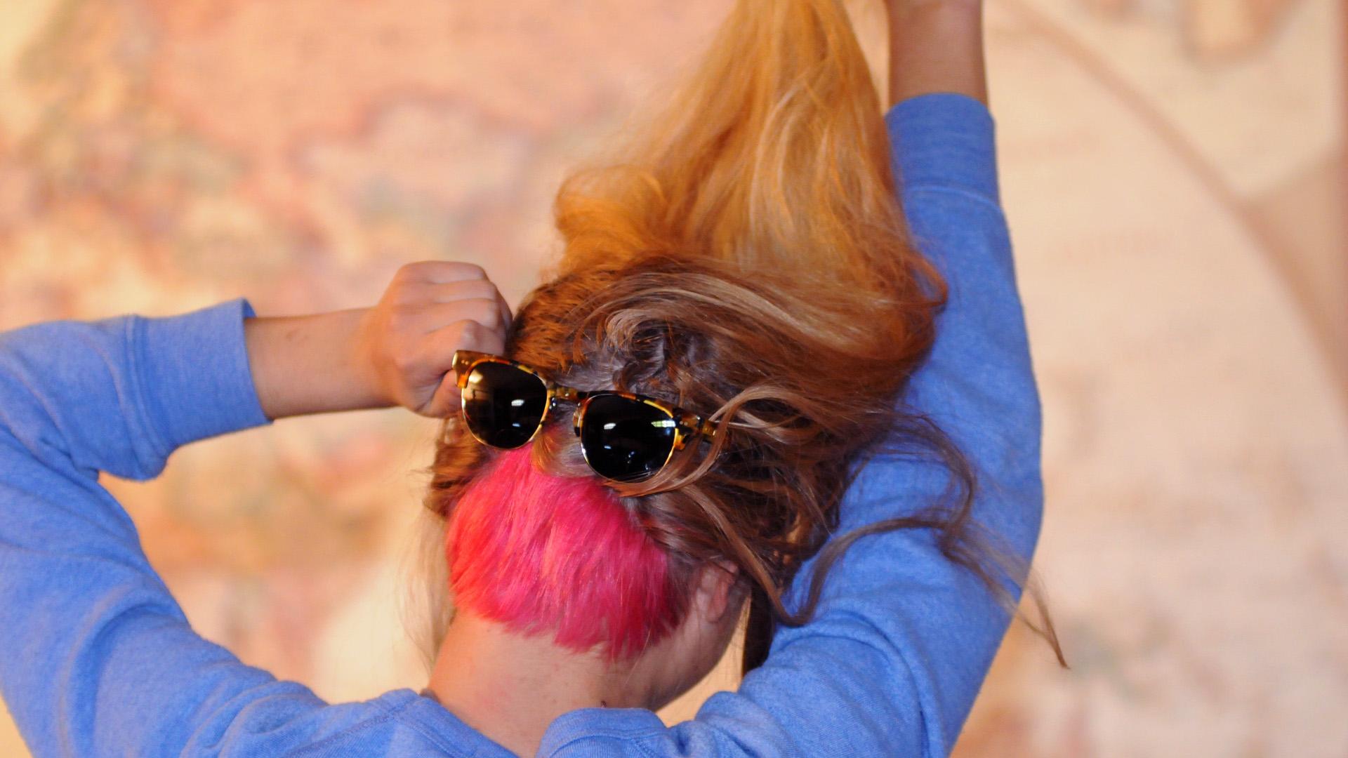 Dasha's pink wedge wearing sunglasses