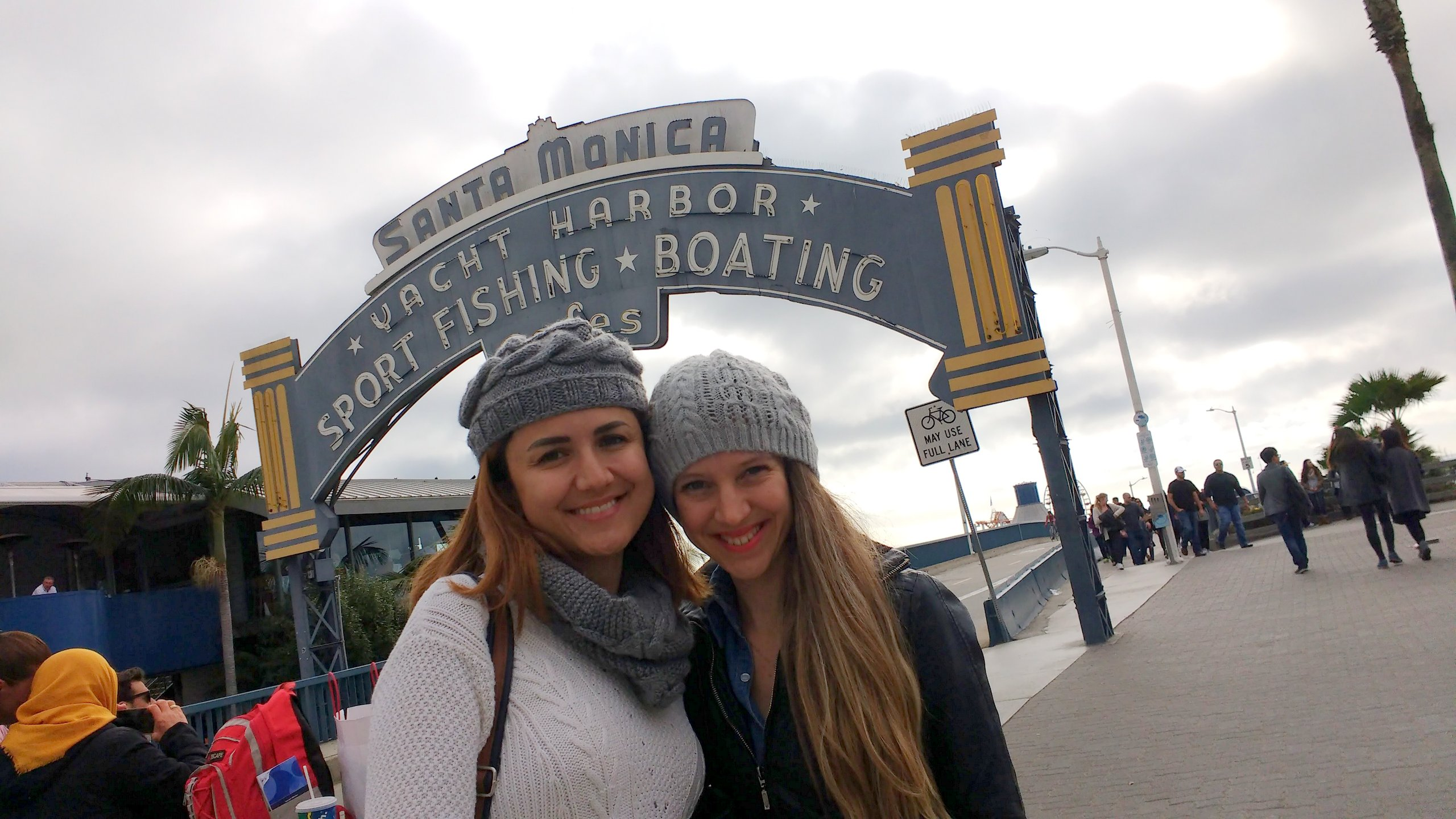 Gizem, Pinar, and the famous Santa Monica Pier neon sign
