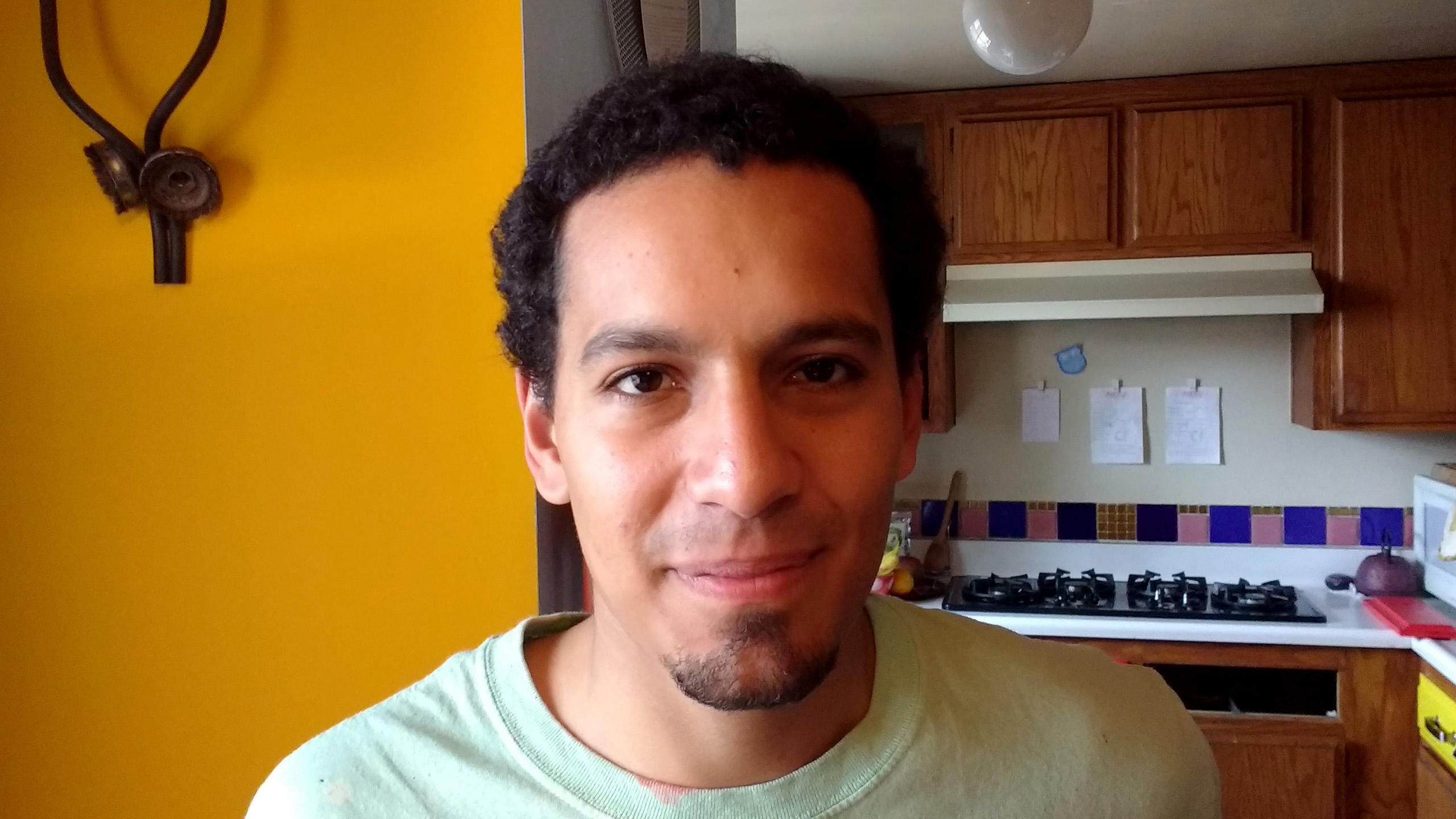 Samuel with dark, curly hair
