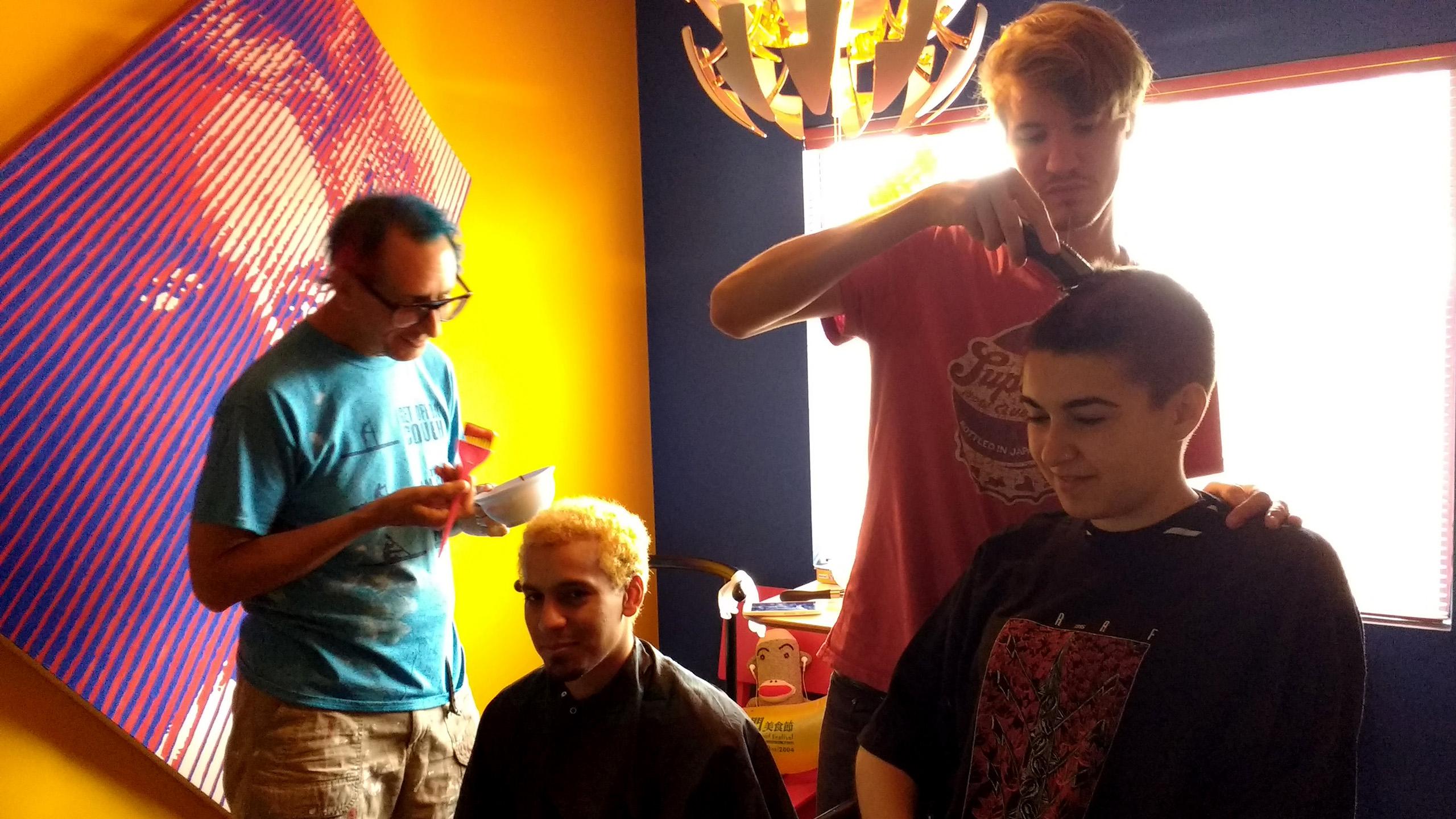 RULA Hair Salon: Glenn applying color to Samuel and Alexis cutting Marta's hair.