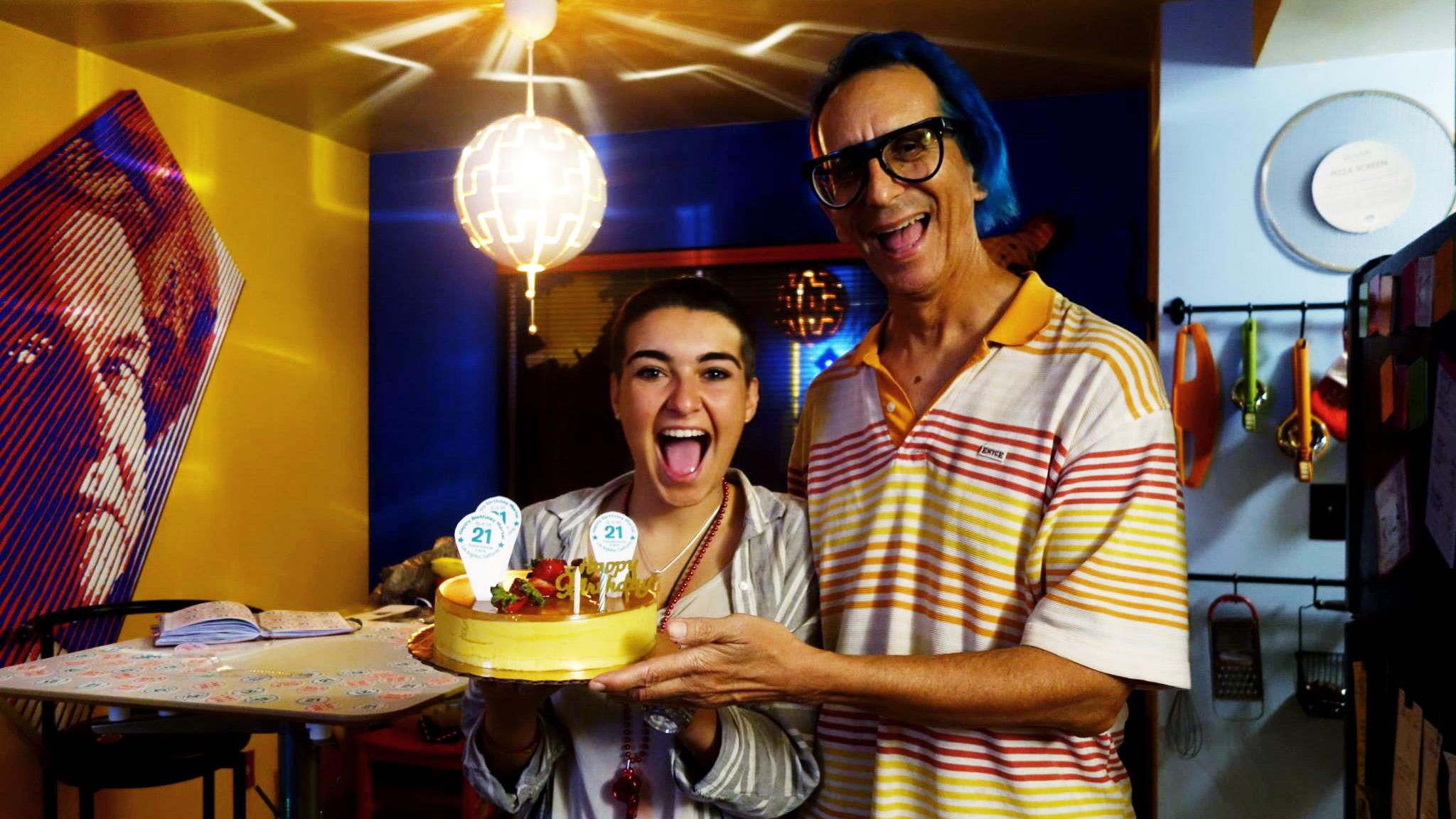 Marta Troya & Glenn Zucman holding Marta's birthday cake