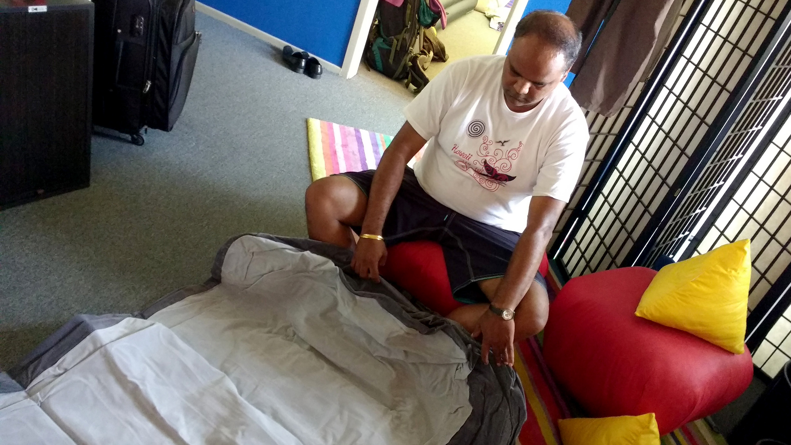 Kamal inflating an air mattress.
