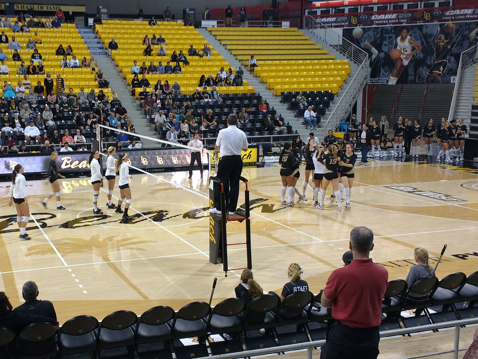 Women's volleyball players on the court at the Long Beach State Pyramid