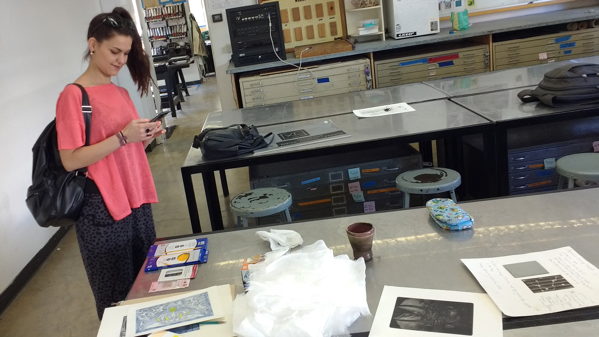 Ele viewing some intaglio works-in-progress at the School of Art's Printmaking Program