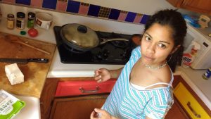 Eleo Rey in the kitchen with a cutting board