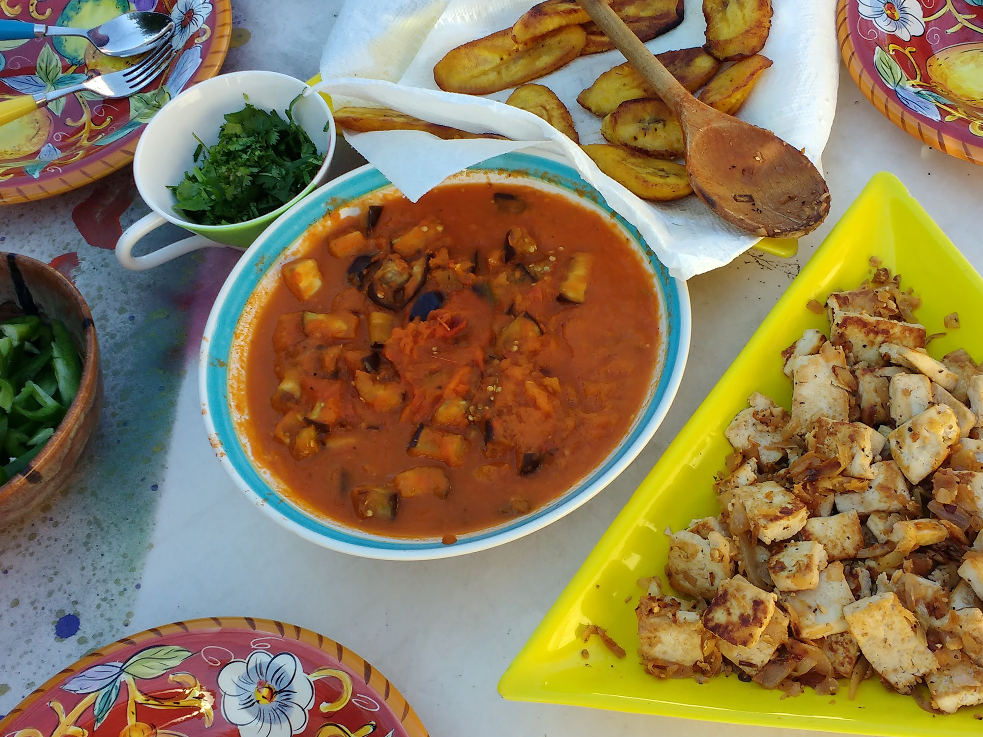 Close-up of dishes of food at an outdoor table