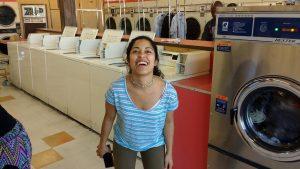 Eleo Rey posing and grinning at Launderland on Garvey Avenue in Rosemead, CA