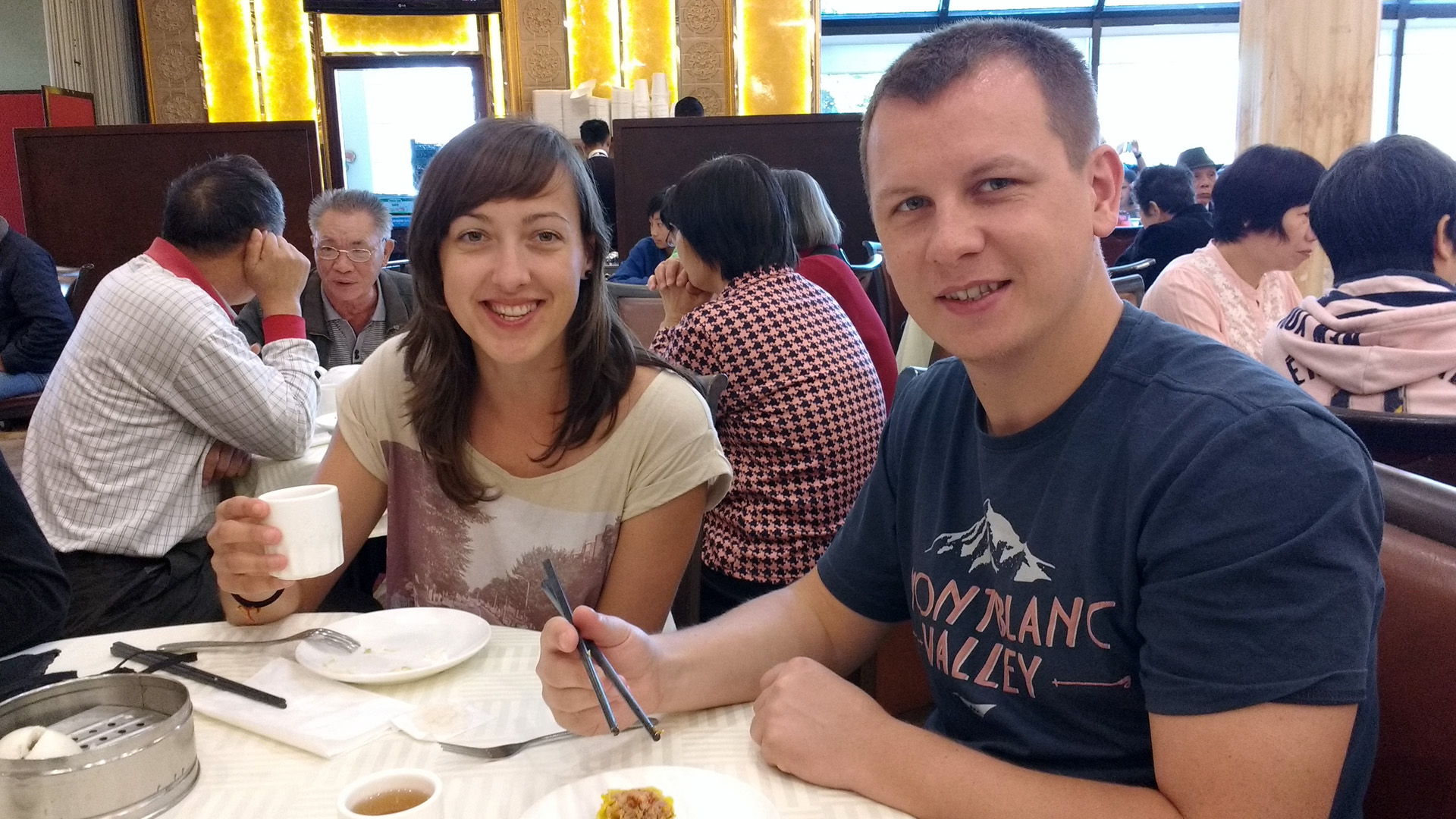 Ida & Czarek at a table eating dim sum at a restaurant in Rosemead, CA
