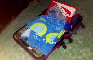 Photo of clothing placed in a suitcase