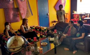 5 people sitting in a living room