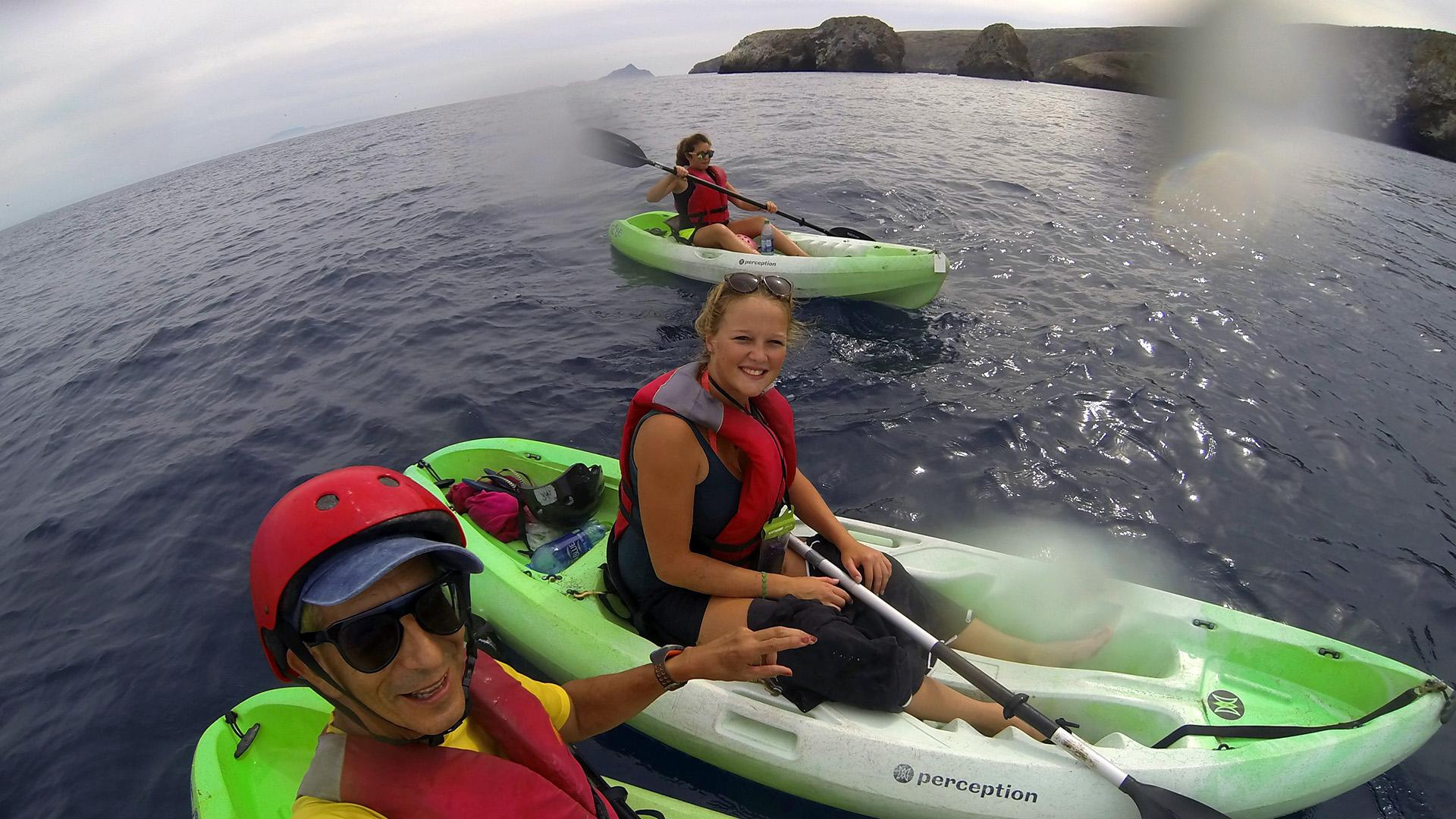 3 kayakers at Scorpion Anchorage, Santa Cruz Island, California Channel Islands