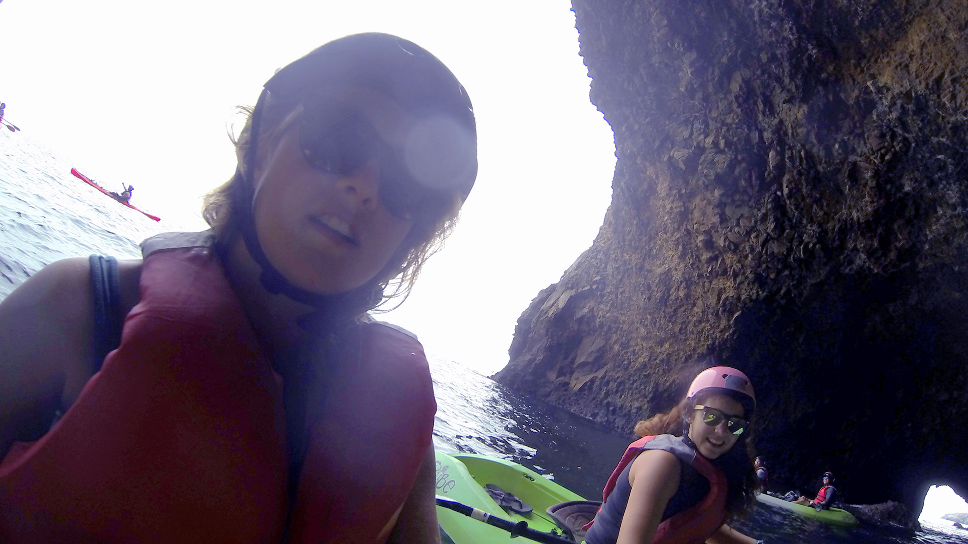 Stefanie Kuisle & Zeinab Greif kayaking inside a sea cave at Santa Cruz island