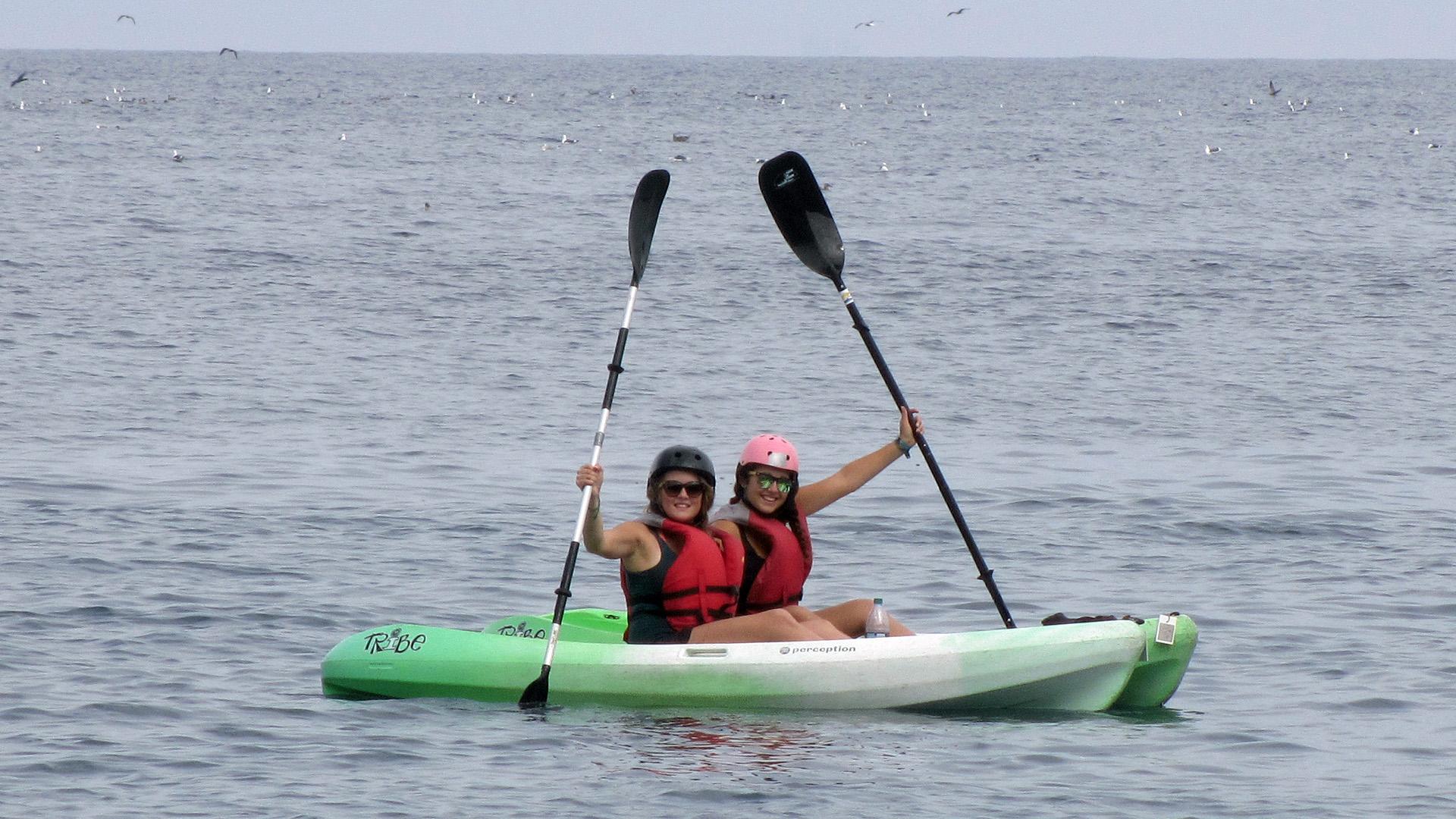 Stefanie and Zeinab kayaking in the ocean