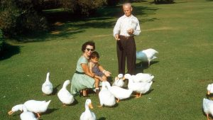 Me, sitting on my mom's lap as my grandfather feeds the ducks at the park