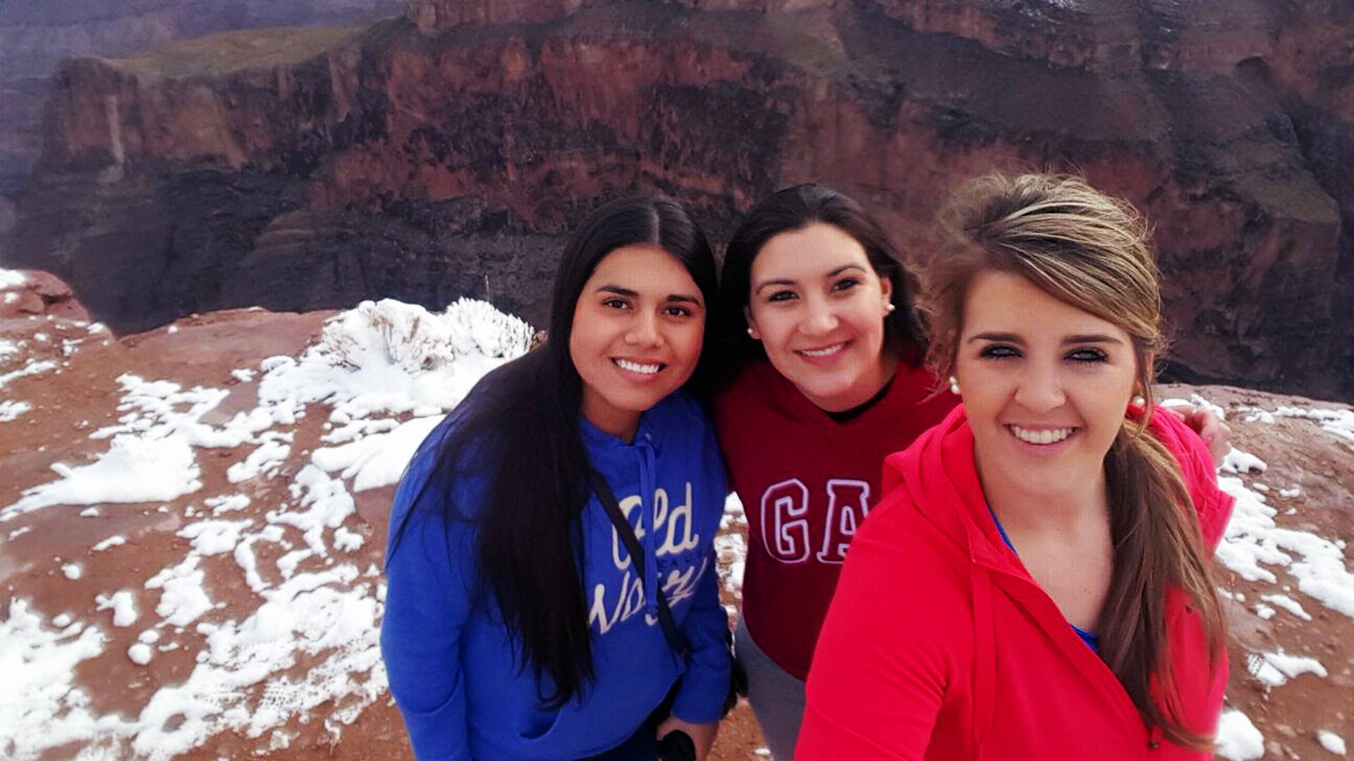 Johanna, Celeste & Daleen at the rim of the Grand Canyon with snow on the ground