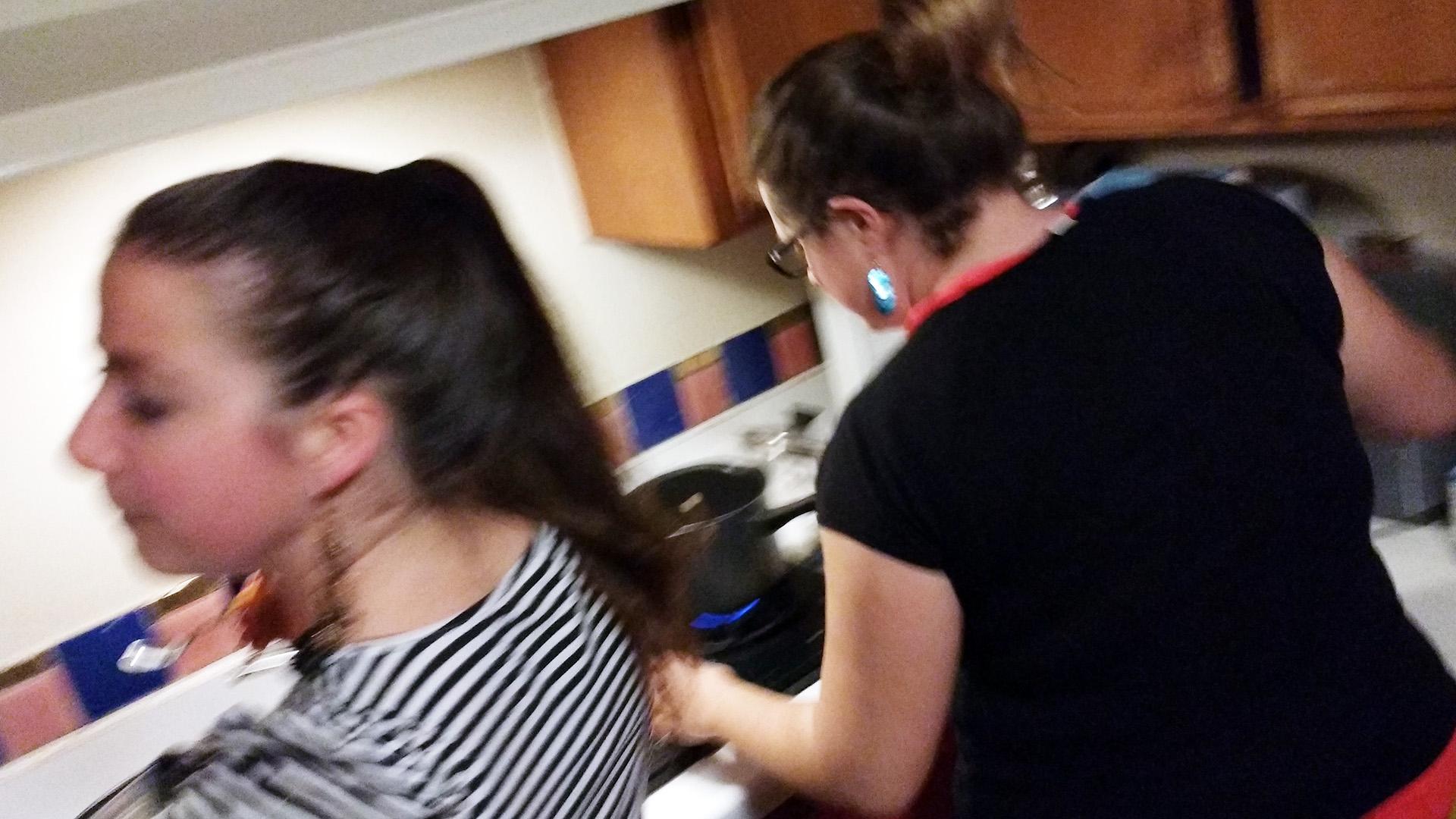 Terézia & Cecile working over the stove