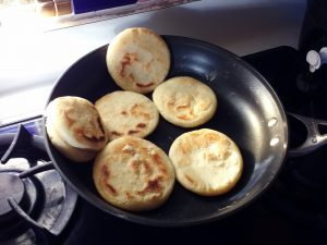 a frying pan filled with arepas