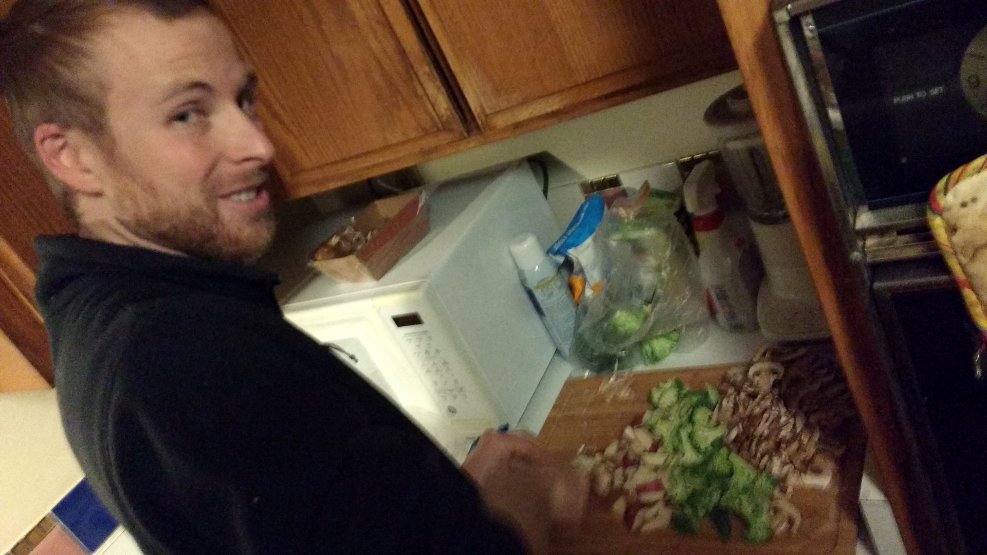 Mike chopping vegetables at a cutting board
