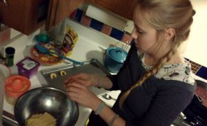 Bianca preparing cookie dough in a stainless steel bowl