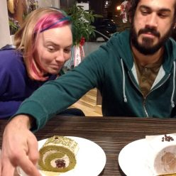 Candi and Darich at a table about to eat dessert