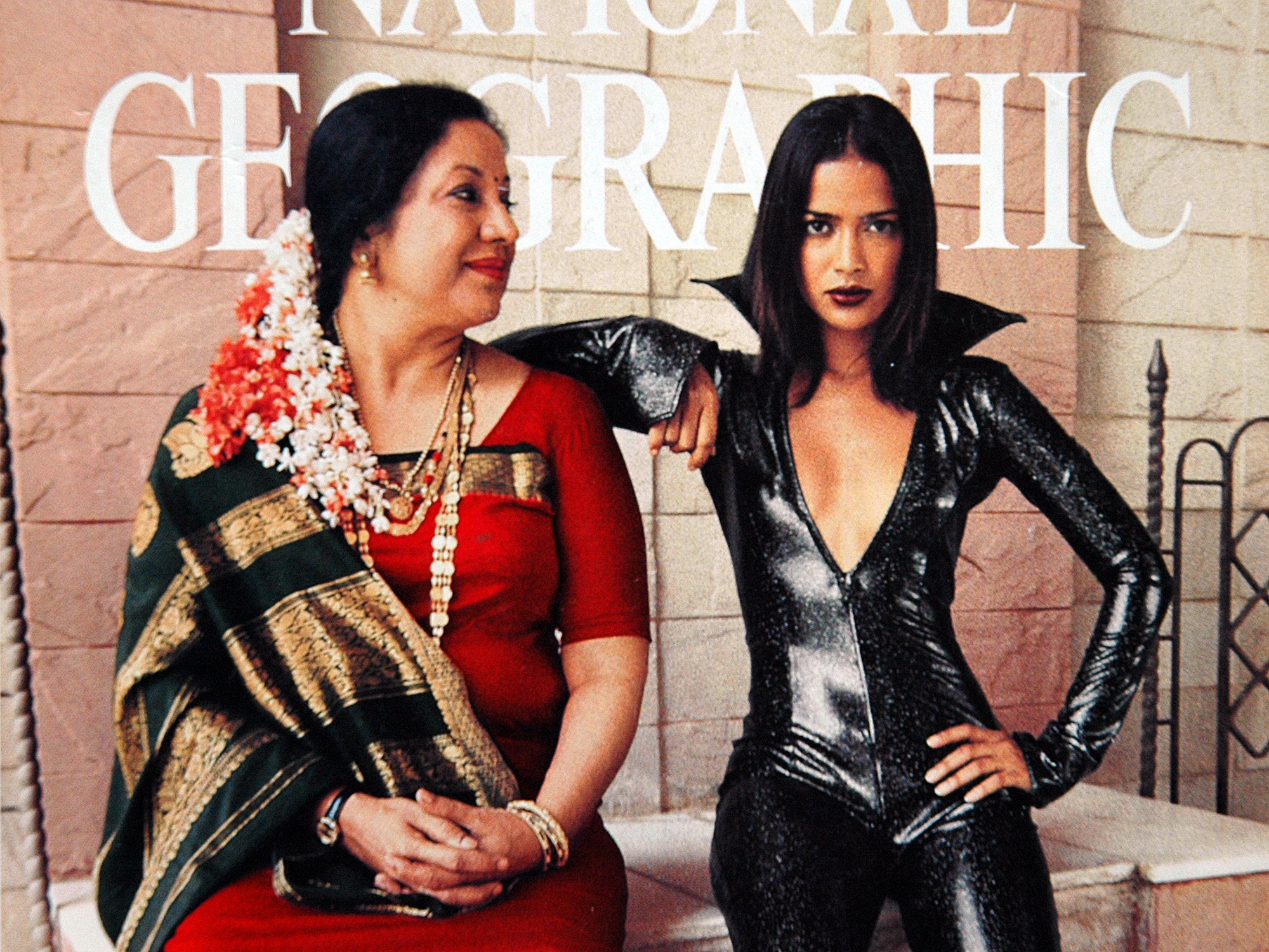 "Cover of National Geographic magazine, August 1999, showing a mother and daughter dressed in ""traditional"" wear for their generations."
