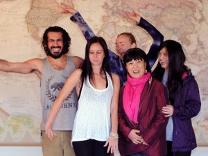 Darich, Ally, Candi, Julia & Joan standing in front of a world map