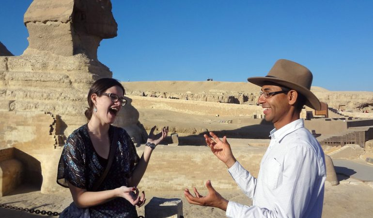 Ahmed mirrors hand gestures with another person near The Sphinx in Egypt
