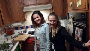 Gizem & Pinar standing and smiling in the RULA Kitchen
