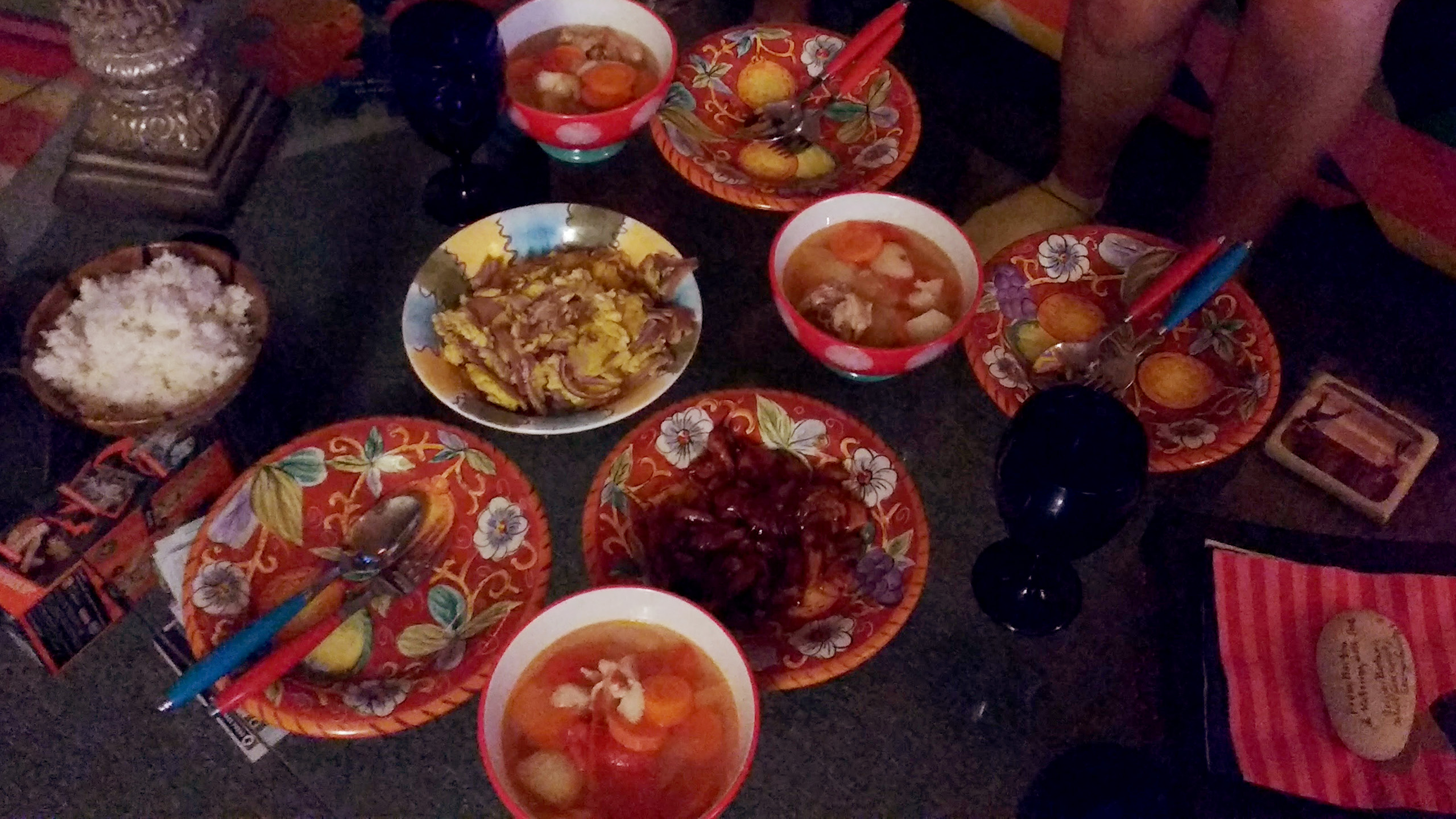 a table filled with different food dishes
