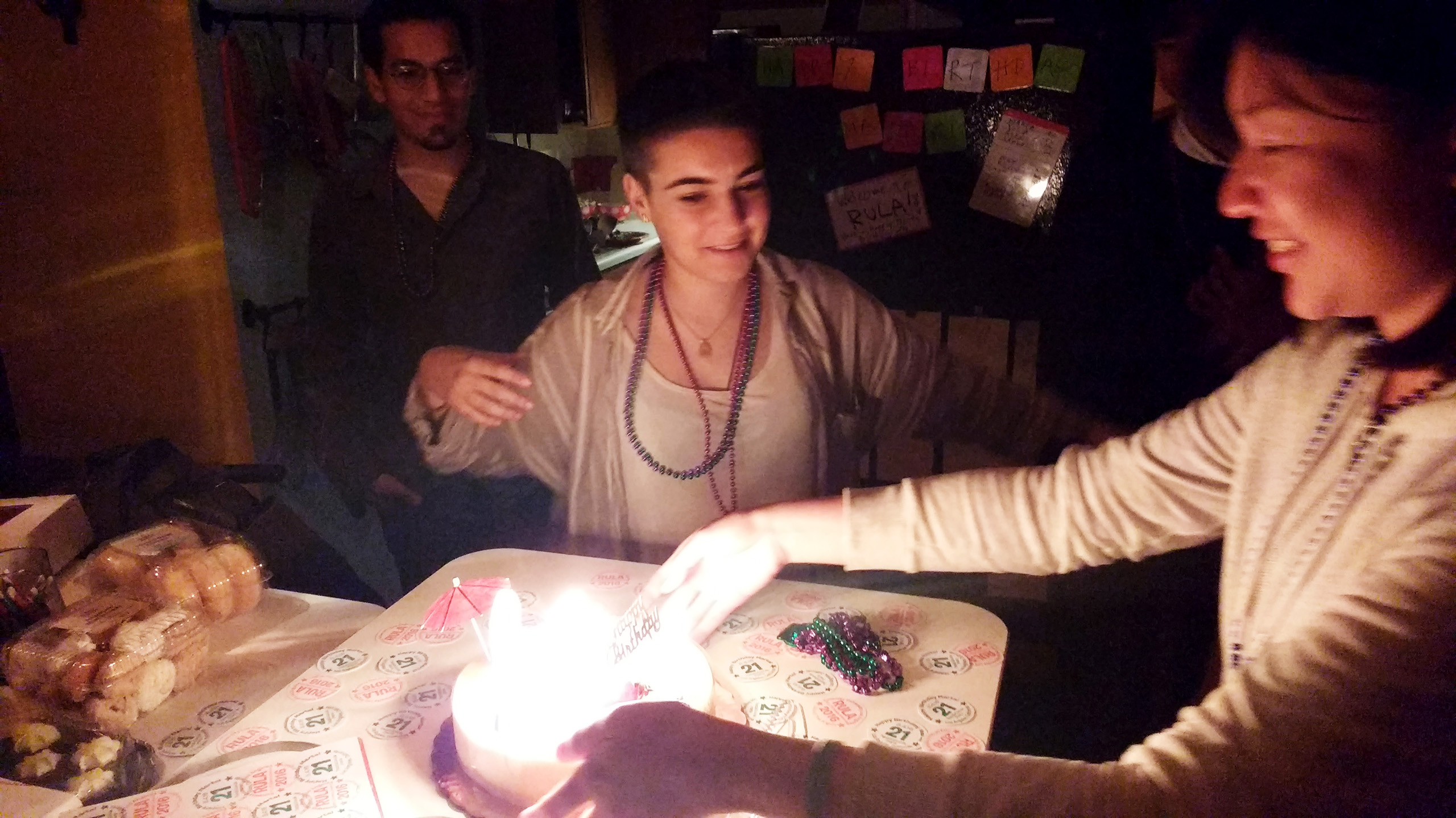 Ada lights candles on Marta's cake